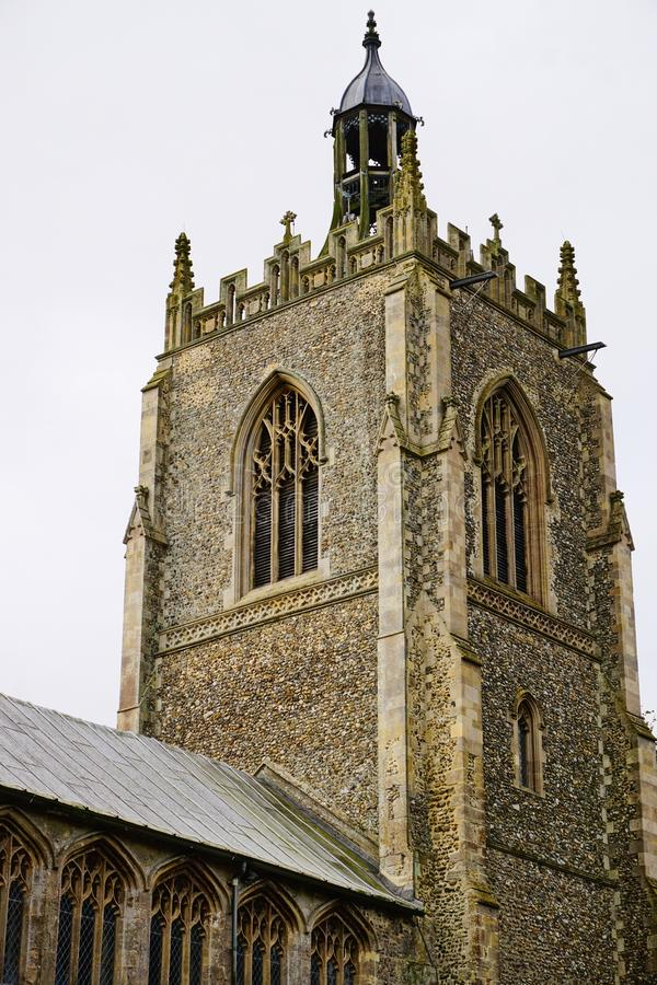 Church tower. Village church bell tower situated in Necton Norfolk. This church dates back to the 14th century and the current bells are 180 years old stock photography
