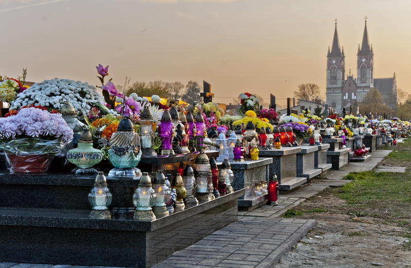 All Saints' Day. Graves with flowers and candles on cemetery during All Saints' Day royalty free stock photos