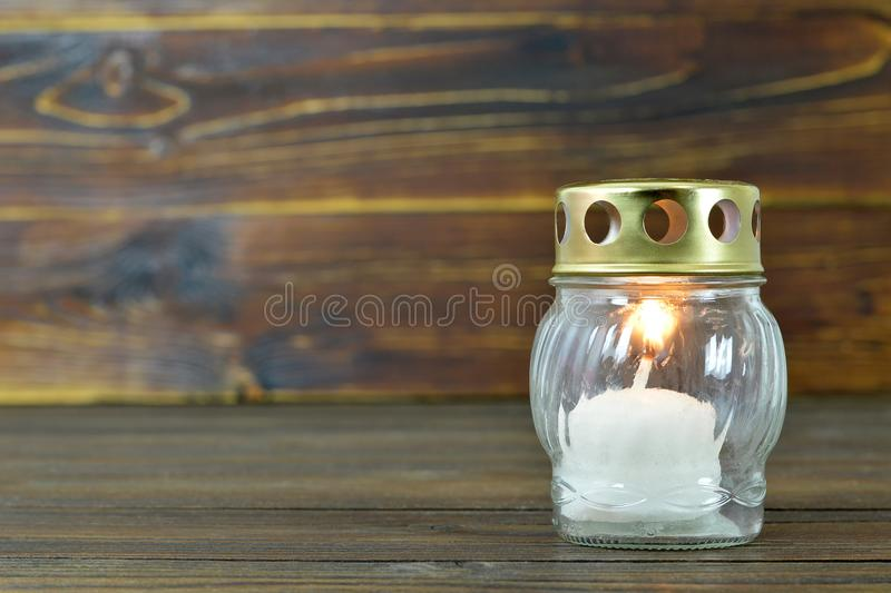 All Saints Day candle. White votive candle stock photography