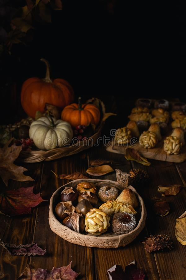 Free All Saints Day Marzipan Sweet Panellets And Roasted Chestnuts, Autumn Leaves On Wooden Table Royalty Free Stock Photography - 162535247