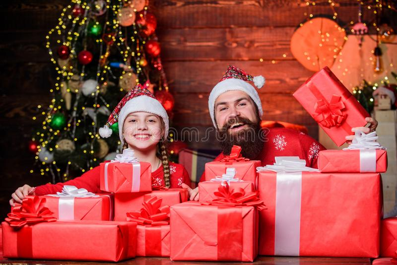 All this is from santa. Happy holidays. Favorite childhood memories of christmas. Father bearded man and daughter near royalty free stock images