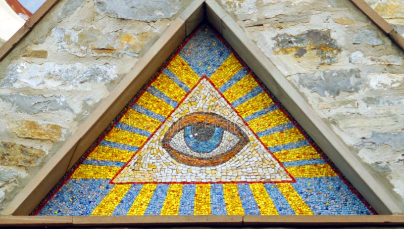 All-seeing eye of God - a mosaic of wall background medieval church. Eye of Providence - famous symbol of Masons and Illuminati royalty free stock photos
