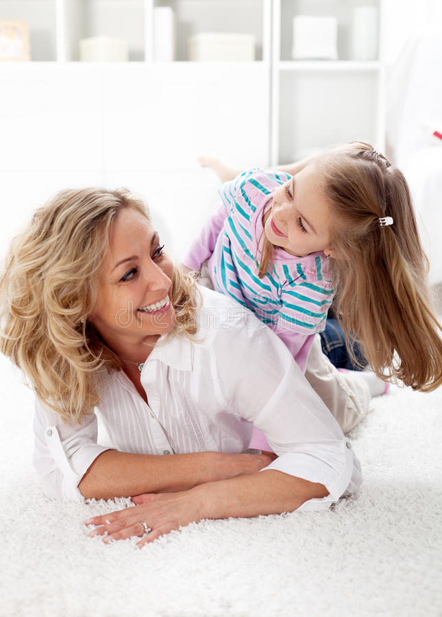 All smiles quality time with mom stock photography