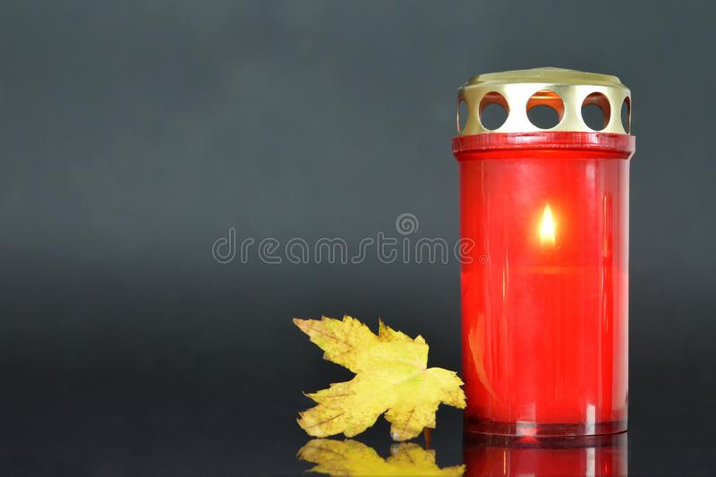 All Soul`s Day. Memorial candle and autumn leaf. All Soul`s Day. Memorial candle and yellow autumn leaf stock photos