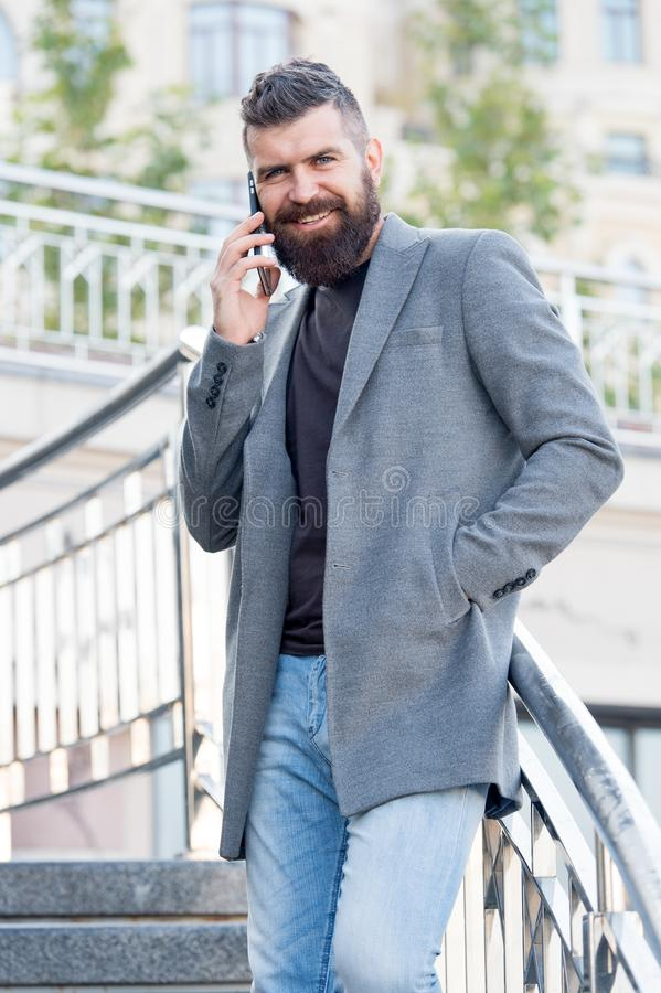 All he talks about is business. Business man. Bearded man has business talks on smartphone. Business communication. New royalty free stock images