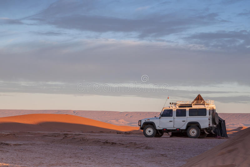 All-terrain car in a desert stock photos