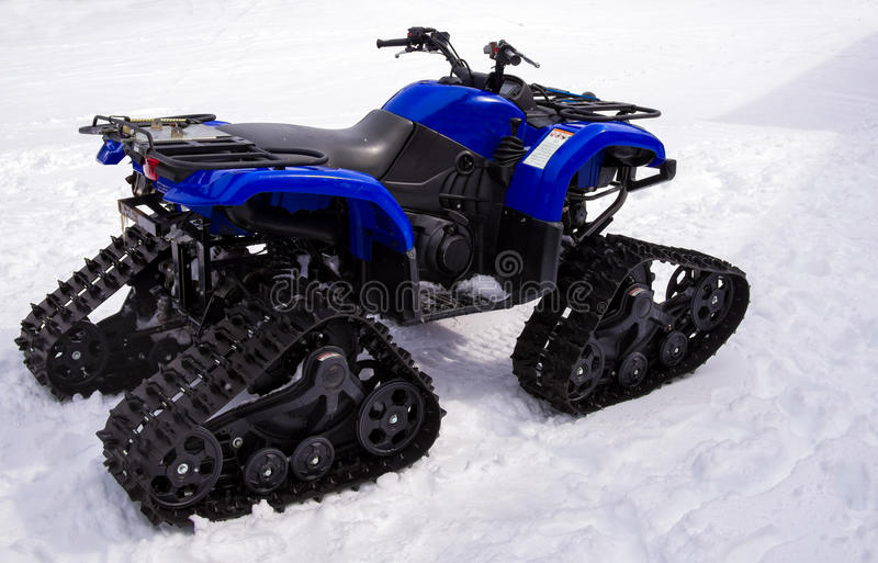 All Terrain Utility Snowmobile Vehicle. Utility all-terrain vehicle (ATV) outside on snow stock images