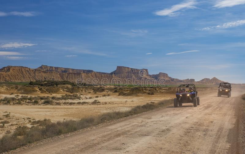 All-terrain vehicle circulating at speed in the desert of the Bardenas. Navarra royalty free stock photography
