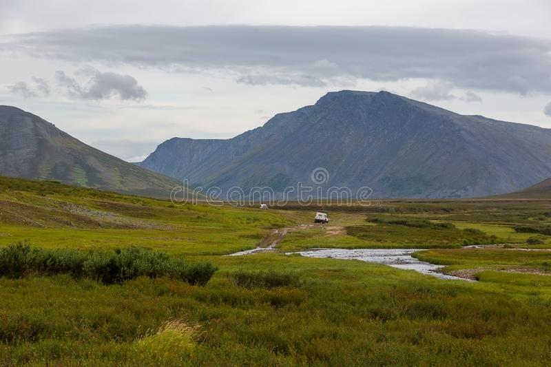 All-terrain vehicle rides on road in tundra. All-terrain vehicle rides on the road in the tundra, Yamal, Russia stock photos