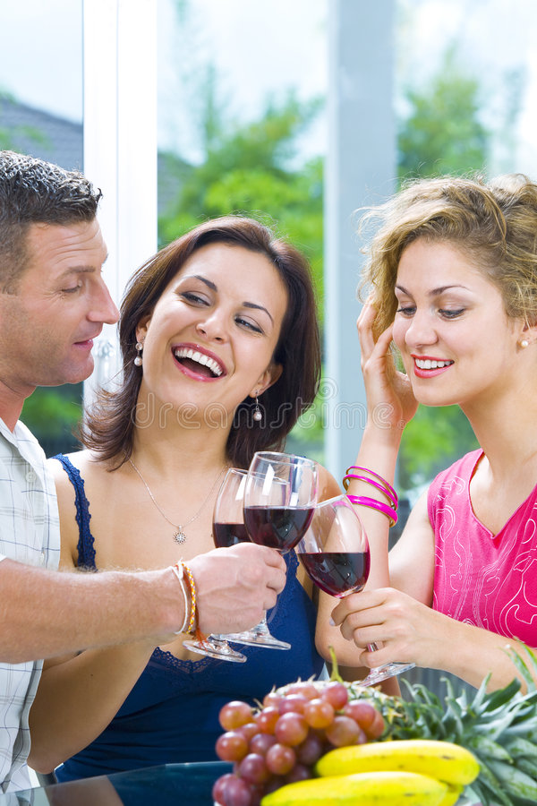 All together. Portrait of young happy attractive people having some wine stock photos