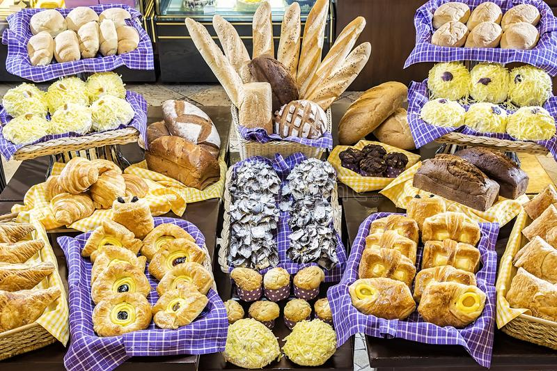 Various Delicious Pastries is Patisserie. All types of delicious pastries set on a table inside a patisserie stock photography