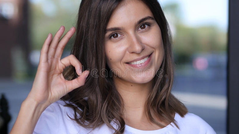 All is Well, Okay Sign by Beautiful Girl Portrait. High quality royalty free stock photography