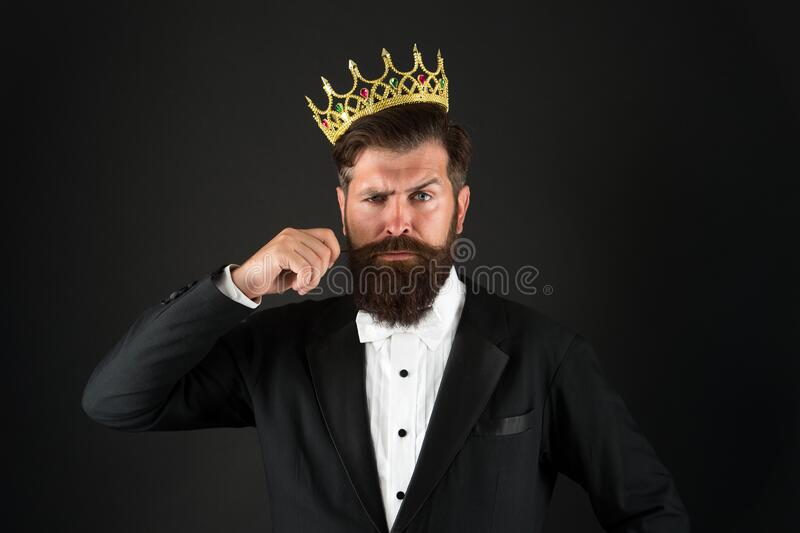 All what they say is true. Handsome bearded guy king. King crown. Egoist selfish man. Superiority complex. Narcissistic. Person. Love yourself. Sense of self royalty free stock photography