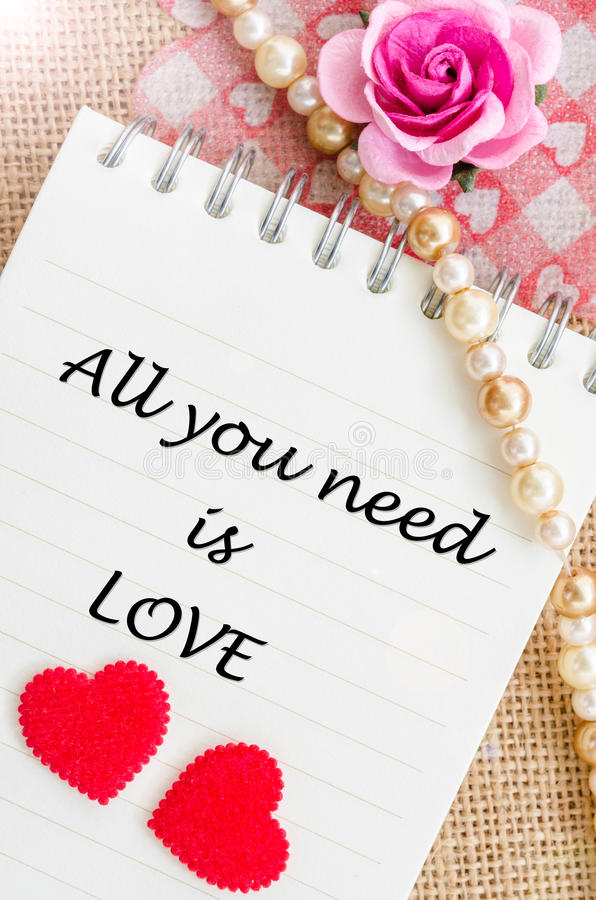 All you need is love on diary with red heart and rose. stock image