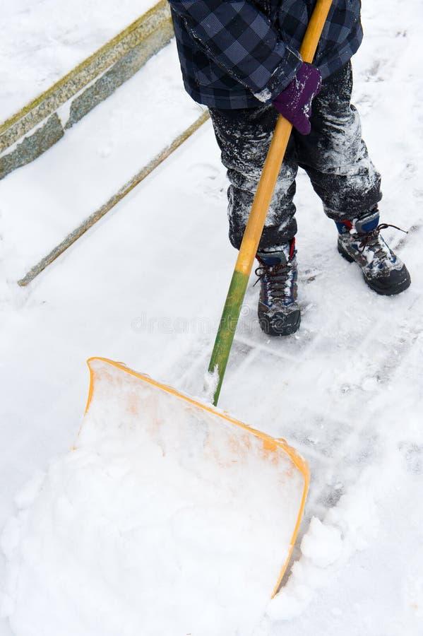 Alla neve della pala fotografia stock
