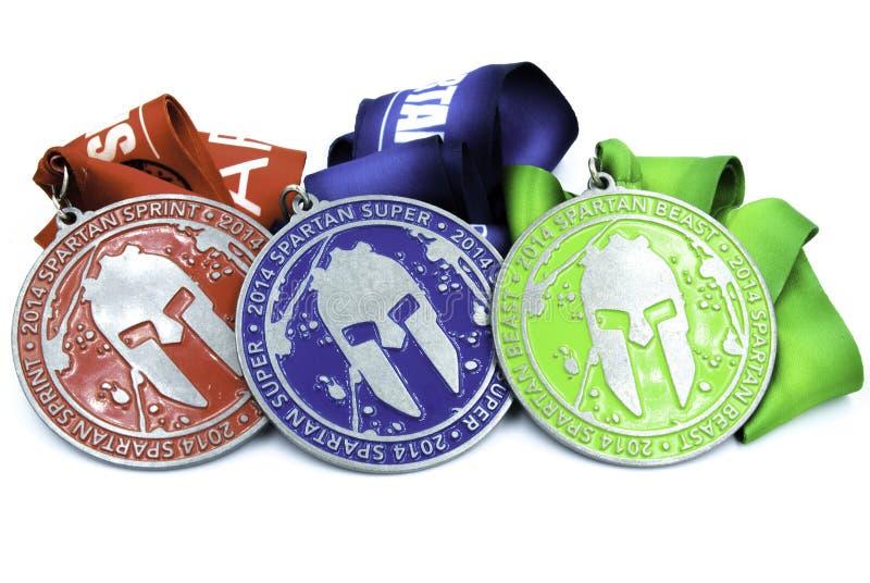 Alla spartanska loppmedaljer - sprinta toppet och fät arkivbild