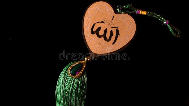 Allah och hans namn i betydelse för arabiskabokstavsgud av arabiskan royaltyfria bilder