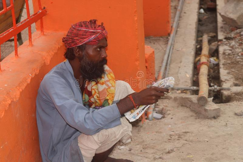A old man reading pepar in allahabad india. Allahabad sangam in india reading pepar stock images