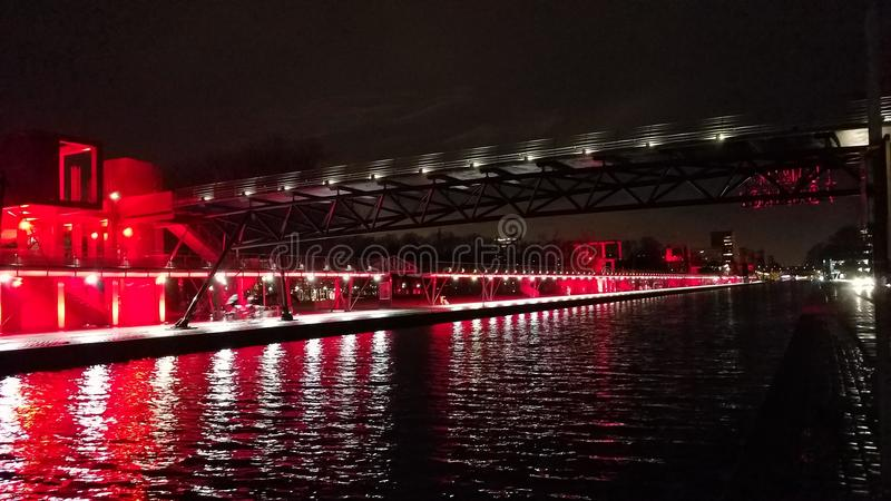 Allee de Canal in La Villette Paris, France. Illuminated in Red and White at night royalty free stock images
