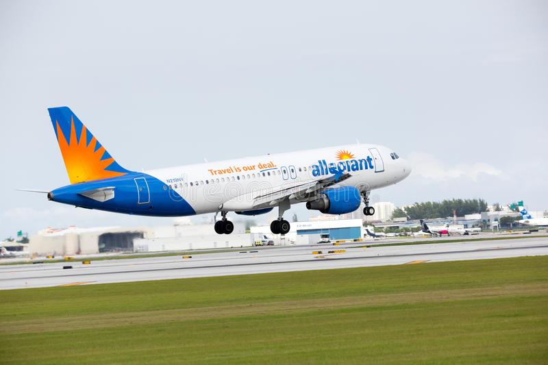 An Allegiant Airlines Airbus A319 landing royalty free stock photo