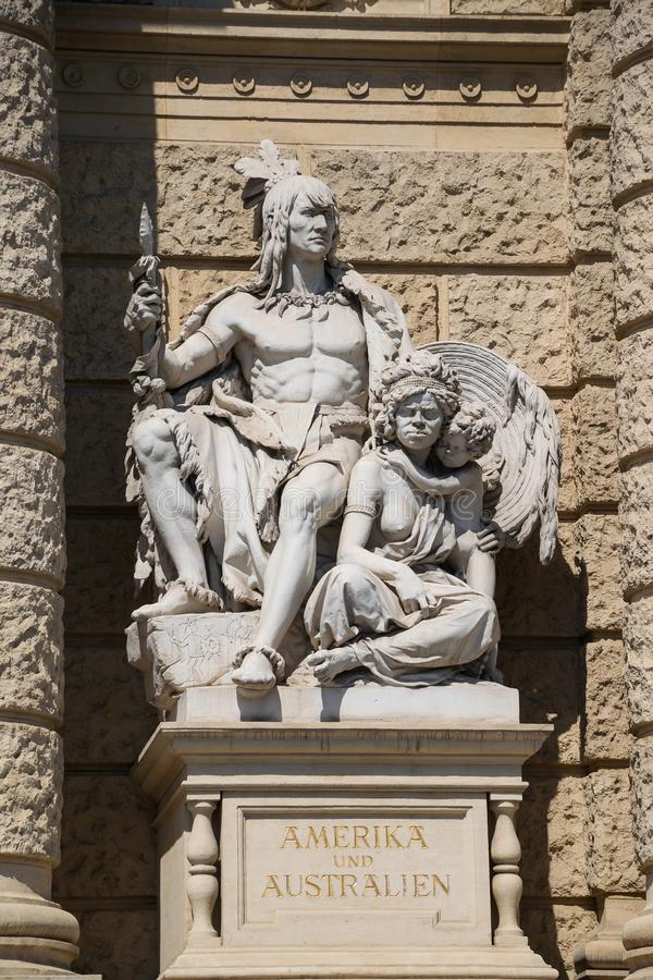Allegoric sculptures of America and Australia continents on a front facade of Natural History Museum in Vienna, Austria stock images