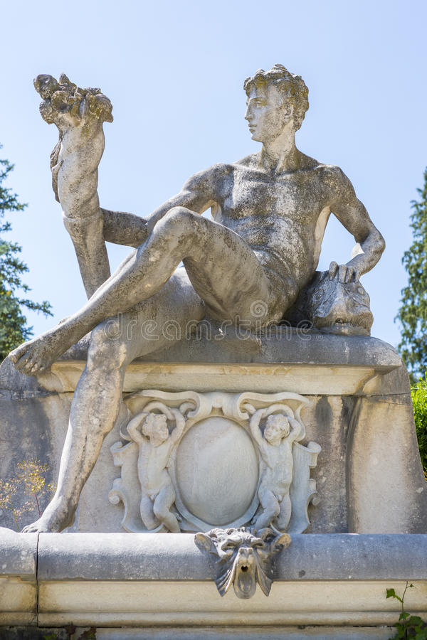 Allegoric stone male statue royalty free stock photography