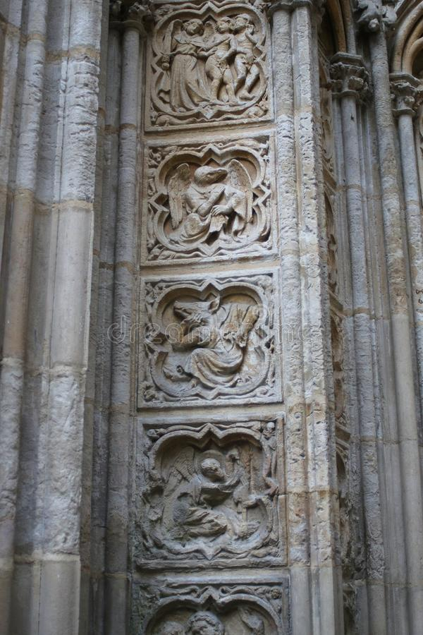 Allegorical Medieval characters carved on the wall of Rouen Cathedral royalty free stock photos