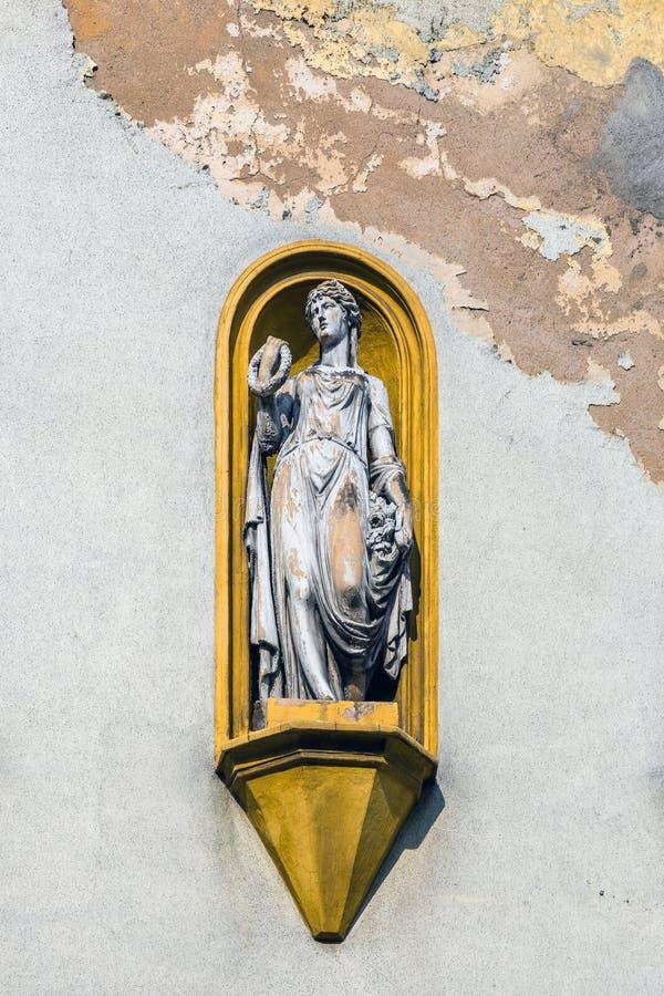 Allegorical statue on the facade royalty free stock photos