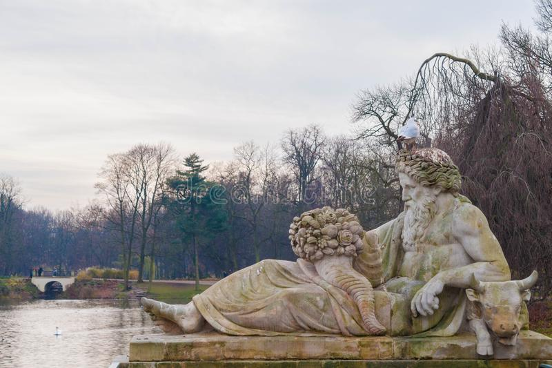 Allegory of the Bug river, statue in Lazienki Park, Warsaw, Poland royalty free stock photo