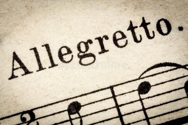 Allegretto - fast music tempo. Allegretto - fast, quickly and bright music tempo (close to but not quite allegro) - macro detail from vintage sheet music stock images