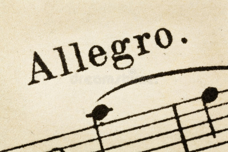 Allegro - fast music tempo. Allegro - fast, quickly and bright music tempo - macro detail from vintage sheet music royalty free stock photography