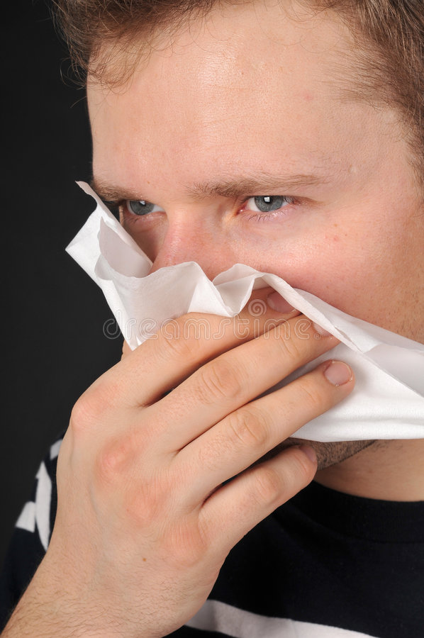 Allergies cold flu. Person with a cold or allergy. Isolated on black royalty free stock photography