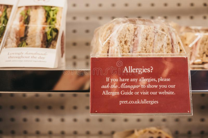 Allergies notice next to sandwiches inside Pret a Manger, London, UK. London, UK - February 23, 2019: Allergies notice next to sandwiches inside Pret a Manger, a stock images