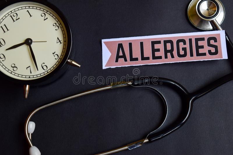 Allergies on the paper with Healthcare Concept Inspiration. alarm clock, Black stethoscope. royalty free stock photo