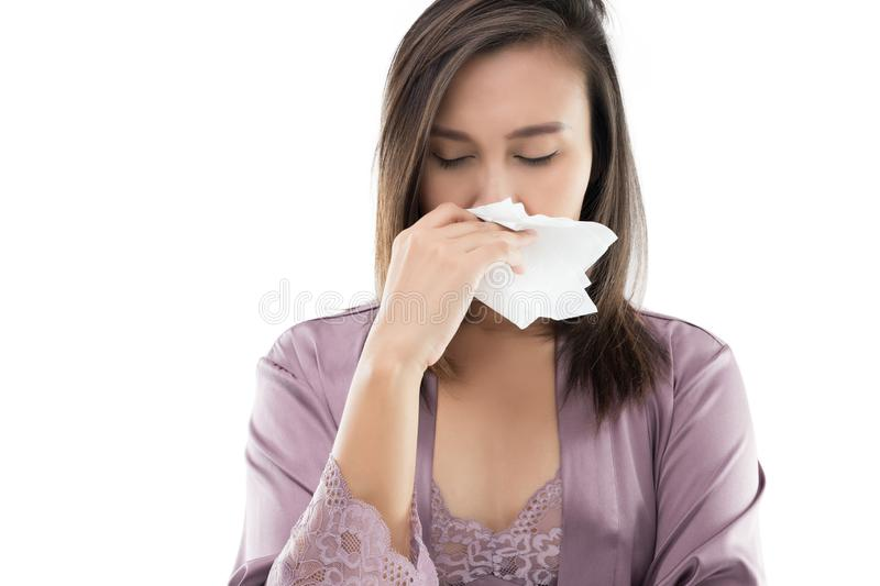 Allergy. Asian Women In Satin Nightwear Feeling Unwell And Sneeze Against White Background, Dust Allergies, Flu, People Caught Cold And Allergy royalty free stock image