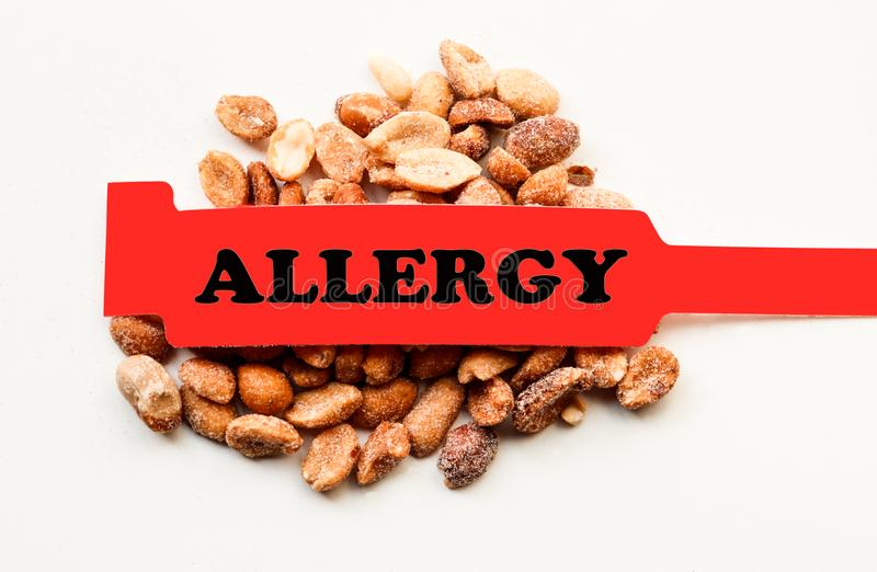 Allergy Bracelet Over Peanuts royalty free stock photography