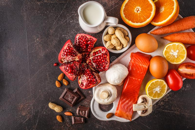 Allergy food concept. Allergies to fish, eggs, citrus fruits, ch. Ocolate, mushrooms and nuts. Health and medicine in food. Dark background, top view, copy space stock images