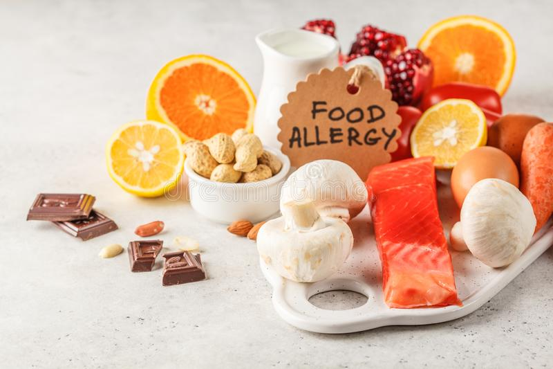 Allergy food concept. Allergies to fish, eggs, citrus fruits, ch. Ocolate, mushrooms and nuts. Health and medicine in food. White background royalty free stock photo