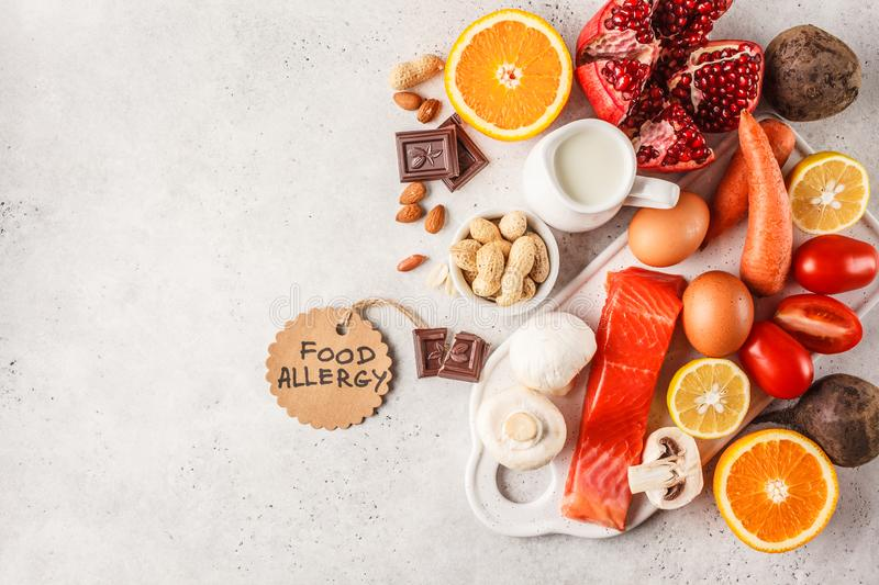Allergy food concept. Allergies to fish, eggs, citrus fruits, ch. Ocolate, mushrooms and nuts. Health and medicine in food. White background, top view, copy royalty free stock photography