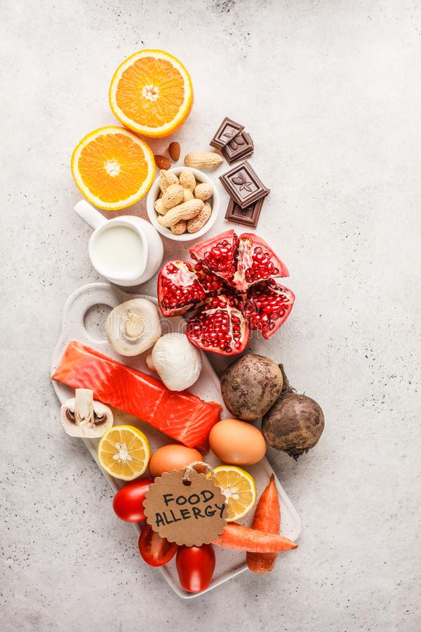 Allergy food concept. Allergies to fish, eggs, citrus fruits, ch. Ocolate, mushrooms and nuts. Health and medicine in food. White background, top view, copy stock photography