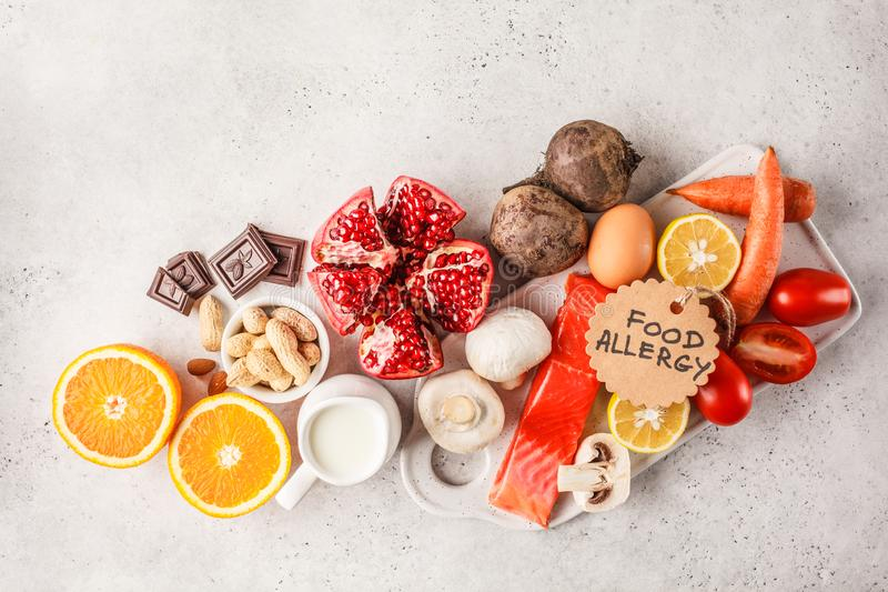 Allergy food concept. Allergies to fish, eggs, citrus fruits, ch. Ocolate, mushrooms and nuts. Health and medicine in food. White background, top view, copy royalty free stock photo