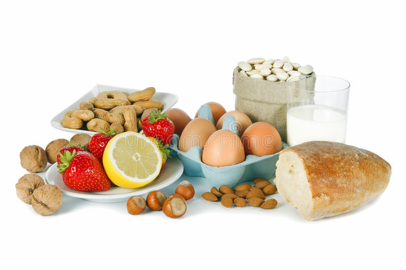 Allergy food. Concept - bread, milk, fruits, nuts, eggs and beans on white background stock image