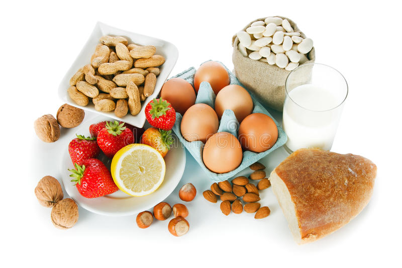 Allergy food. Concept - bread, milk, fruits, nuts, eggs and beans on white background royalty free stock photos