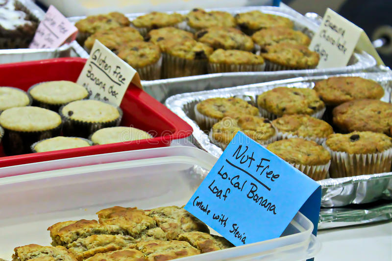Allergy items at a bake sale.  stock image