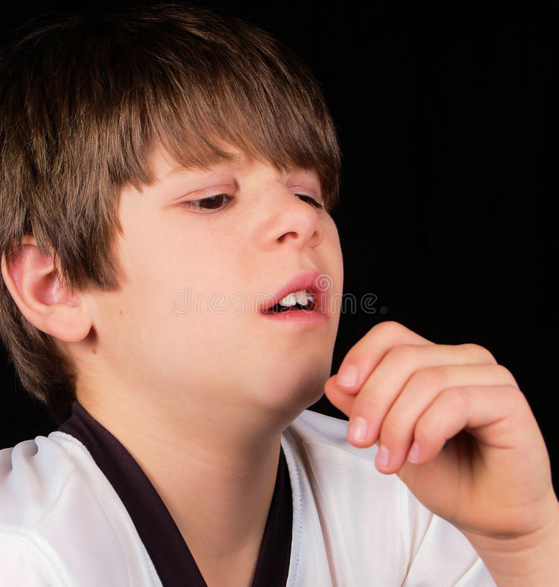 Allergy Sneeze. This child is going to sneeze! Is it from allergies, a cold, or simply an itchy nose? You decide stock photography