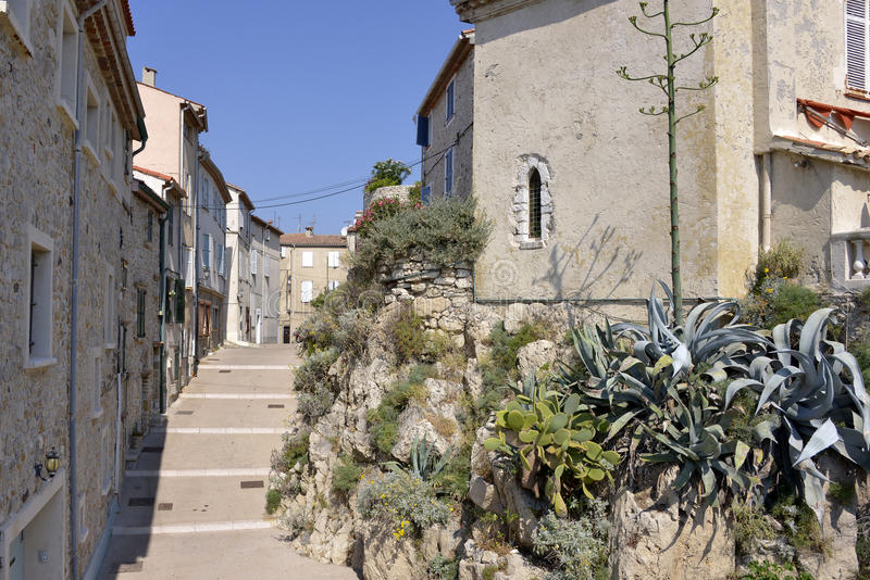 Alley at Antibes in France. Typical alley in the old city of Antibes, commune is a Mediterranean resort in the Alpes-Maritimes department of southeastern France royalty free stock images