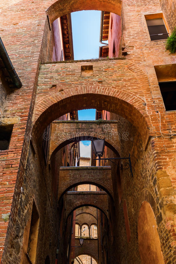 Arches Between Historical Buildings In Siena Stock Photo ...