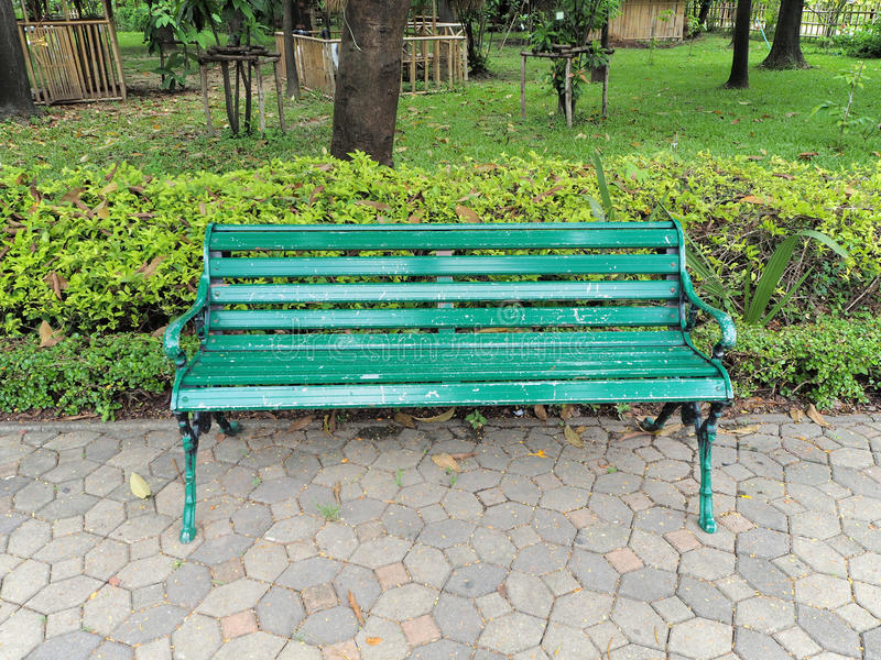 Alley and bench of the garden. Beautiful Spring Park. Green park royalty free stock images
