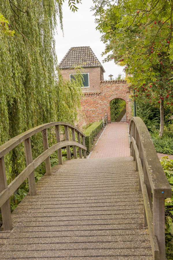 Alley With Bridge Leading To Town Wall Stock Photo