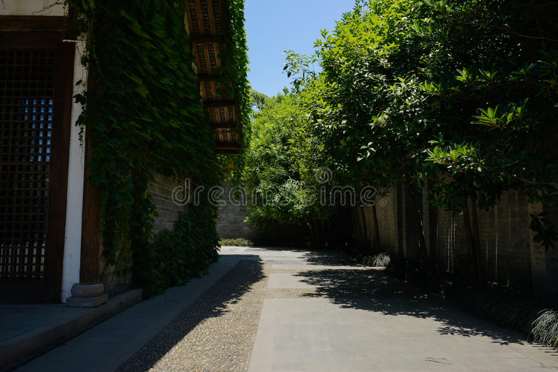 Alley between Chinese traditional building and red brick enclosu stock photo
